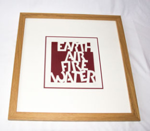 My cut letter design in a double mount and oak frame.